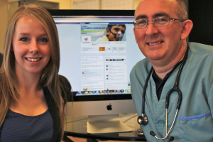 Sara Hamil and Dr. Paul Dempsey at Quinte Pediatrics in front of website