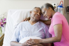 couple in hospital bed hugging