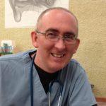 headshot Dr Paul Dempsey