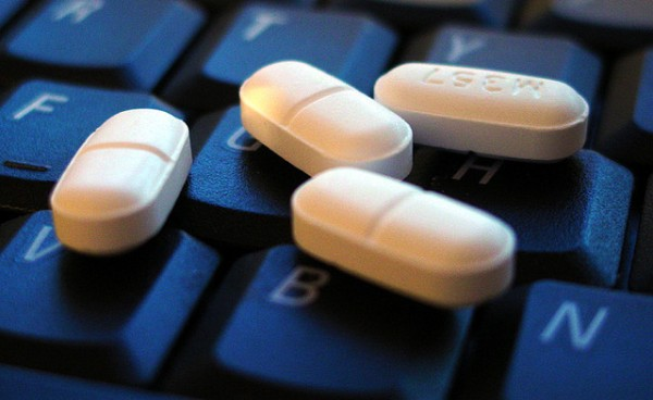 pills on computer keyboard